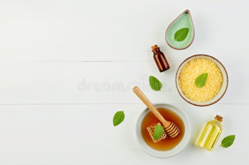Homemade lemon essential oil, salt bath and fresh honey in the p royalty free stock images
