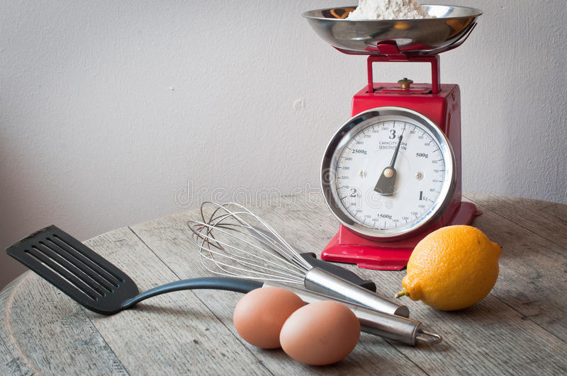 Homemade lemon pancakes. All the ingredients and utensils necessary for making pancakes laid out on a rustic wooden surface stock photo