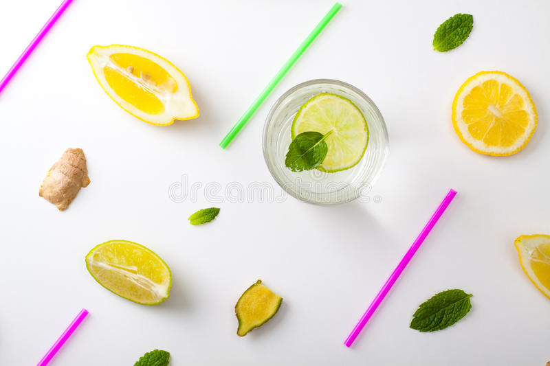 Homemade lemonade. Flat lay ingredients for homemade lemonade. Lemon, lime, ginger and mint for refresh water lay in white background stock image