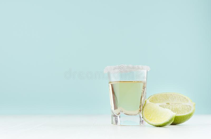 Homemade lemonade with juicy green citrus - pieces lime, sugar rim on edge of glass in fresh mint color interior on white wood. Homemade lemonade with juicy stock photos