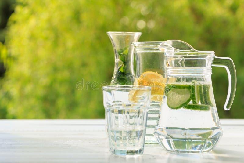 Homemade lemonade with lemon, cucumber and mint royalty free stock photos