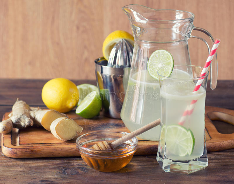 Homemade lemonade. With lemon and ginger on a wooden background royalty free stock photo