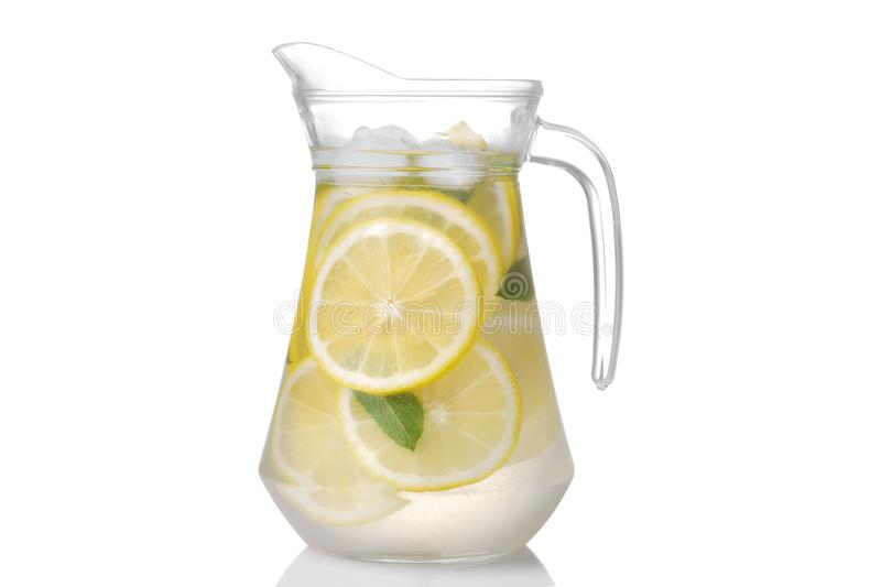Homemade lemonade with mint and ice with a glass jug . isolated. Homemade lemonade with mint and ice with a glass jug on a white background. isolated royalty free stock image