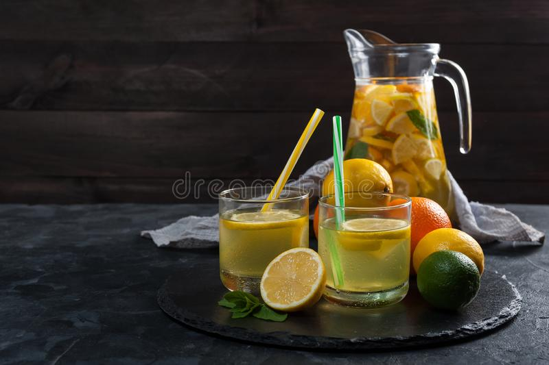 Homemade lemonade with mint. From lemone and orange, citrus refreshig beverage in glass royalty free stock images