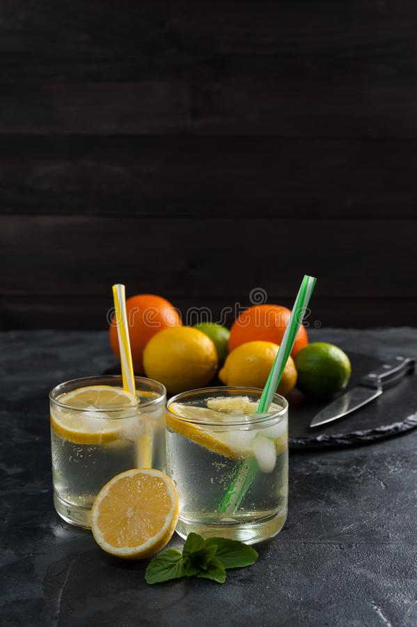 Homemade lemonade with mint. From lemone and orange, citrus refreshig beverage in glass royalty free stock photos