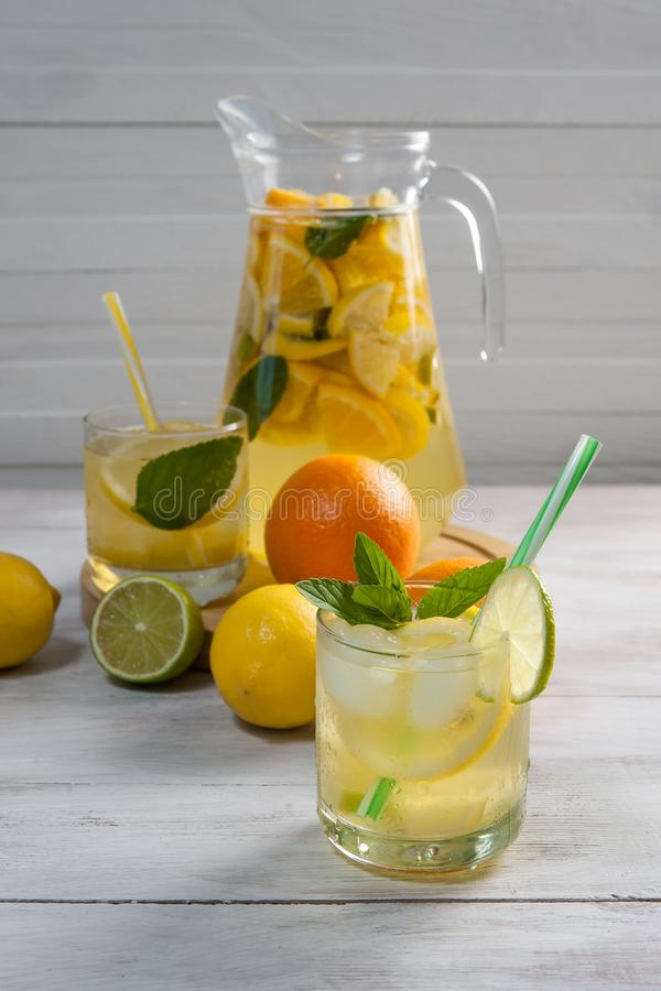 Homemade lemonade with mint. From lemone and orange, citrus refreshig beverage in glass stock photo
