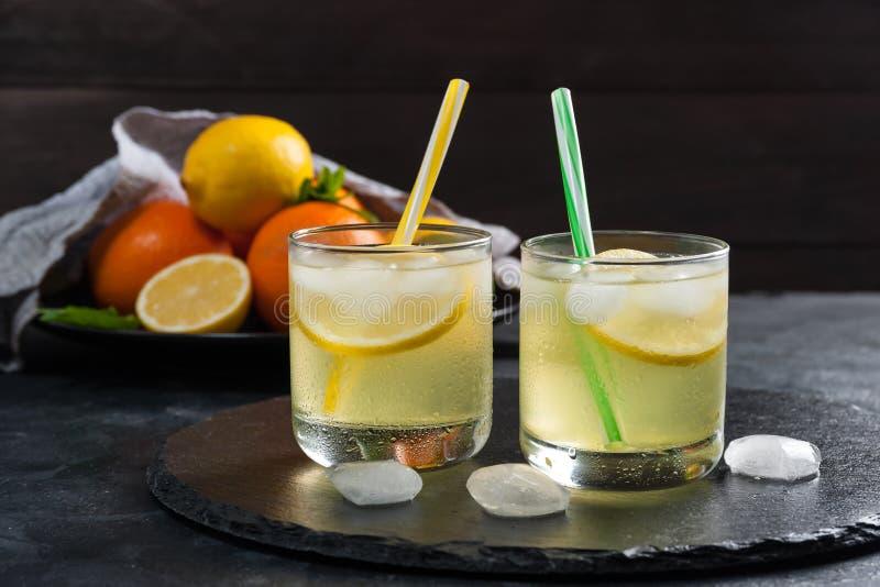 Homemade lemonade with mint. From lemone and orange, citrus refreshig beverage in glass stock image