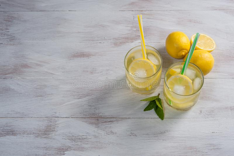 Homemade lemonade with mint. From lemone and orange, citrus refreshig beverage in glass royalty free stock image