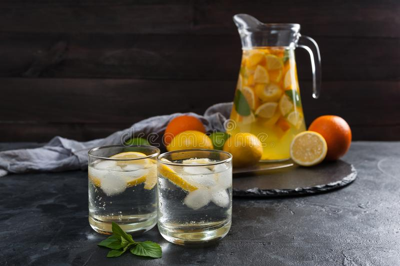 Homemade lemonade with mint. From lemone and orange, citrus refreshig beverage in glass stock images