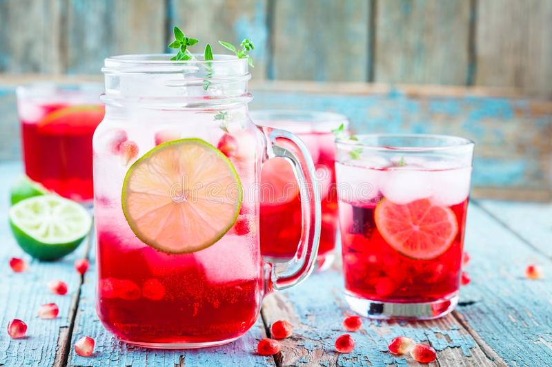 Homemade lemonade with pomegranate, mint and lime. Cold homemade lemonade with pomegranate, mint and lime stock photos