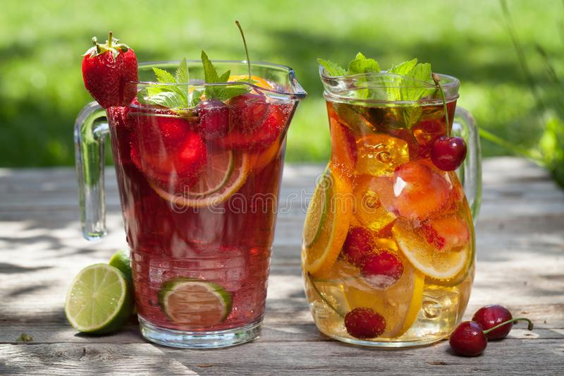 Homemade lemonade or sangria. With summer fruits and berries. Outdoor royalty free stock images