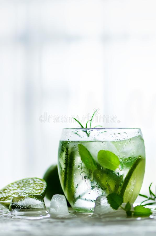 Free Homemade Lime Lemonade With Cucumber, Rosemary And Ice, White Background. Cold Beverage For Hot Summer Day. Copyspace Stock Photos - 114680153