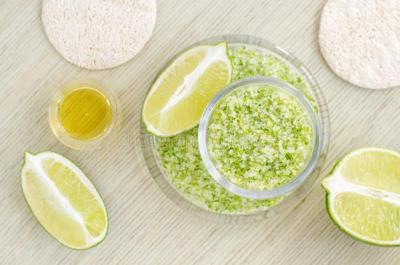 Homemade lime scrub with lime zest and juice, sea salt and olive oil. DIY beauty treatments and spa recipe. Top view, copy space royalty free stock image