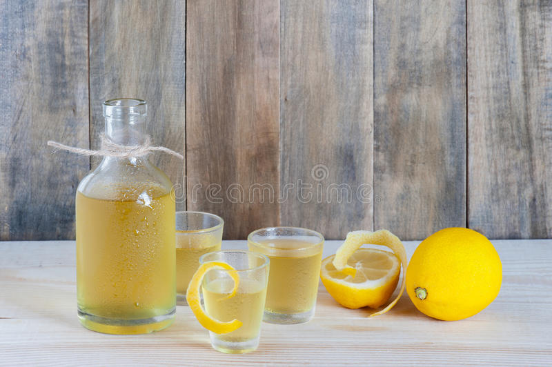 Homemade limoncello on the wooden table royalty free stock photography
