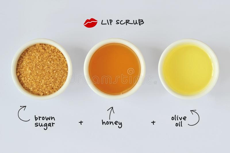 Homemade lip scrub made out of brown sugar, honey and olive oil royalty free stock image