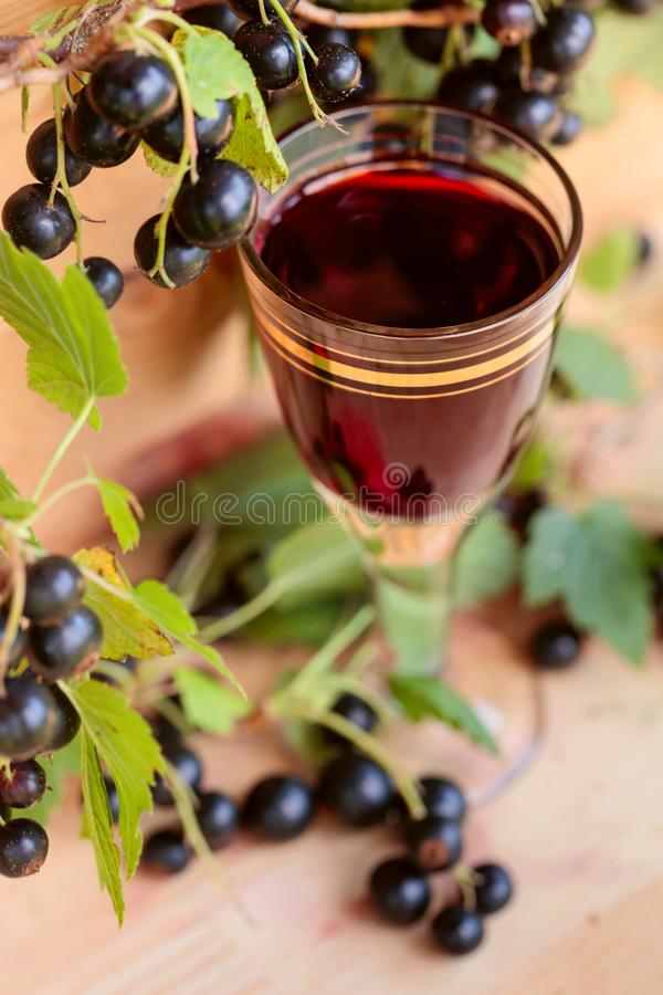 Homemade liqueur made from black currants and fresh berries. stock photo