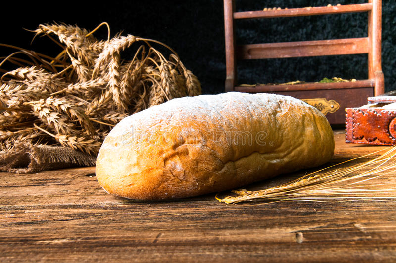Homemade loaf of bread and ingredients stock photography