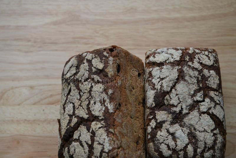 Homemade loaves of rye bread freshly baked on a wood cutting board with overhead view and space royalty free stock photo
