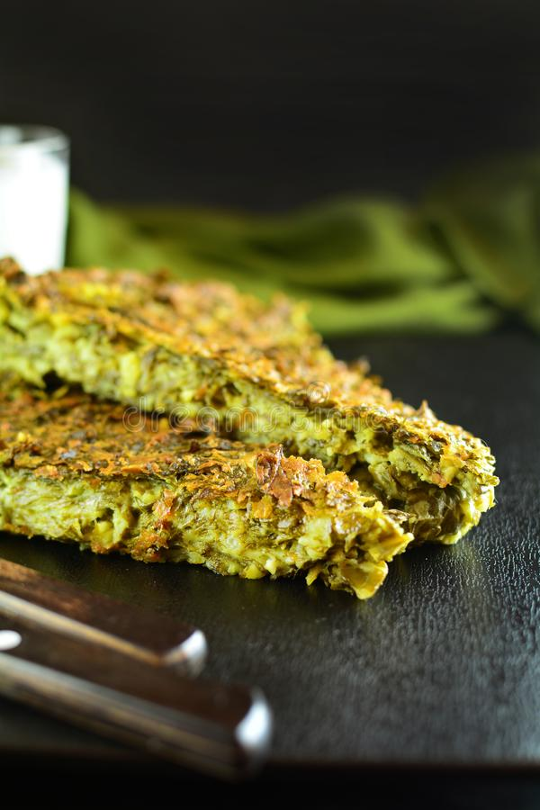 Crustless Keto Spinach Pie with Cheese. Homemade low-carb keto spinach pie with eggs, cheese and almond flour royalty free stock image