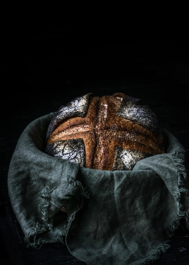 Malt rye bread with poppy seeds dark photo stock image