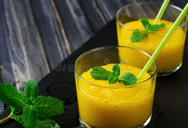 Homemade mango and pineapple smoothie made with coconut milk. stock images