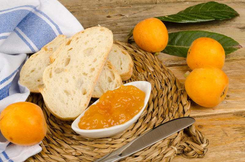 Homemade marmalade. Freshly picked loquats and some homamade marmalade royalty free stock photo