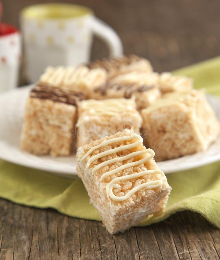 Homemade Marshmallow Rice Crispy Dessert Bar with chocolate. Homemade Marshmallow Rice Crispy on plate royalty free stock image