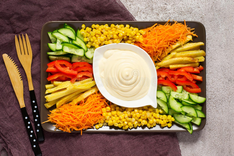 Homemade mayonnaise sauce. Dish with set of colorful vegetables. stock photo
