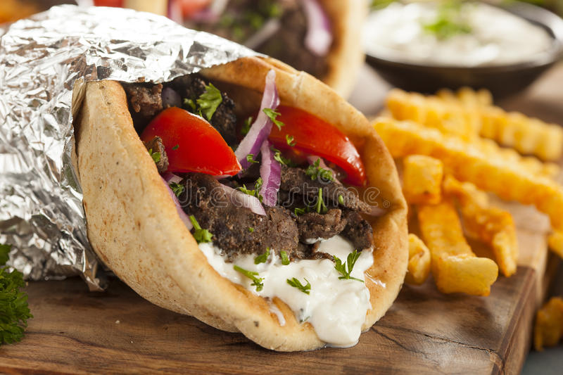 Homemade Meat Gyro with French Fries royalty free stock photos