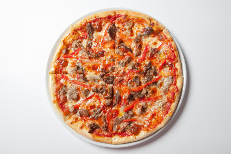 Homemade Meat Loves Pizza with Pepperoni Sausage and Bacon stock photography