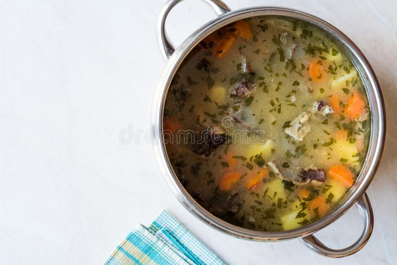 Homemade Meat Stew Beef Rip Soup with Vegetables in Pan. Traditional Organic food royalty free stock photography