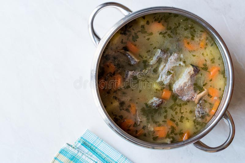 Homemade Meat Stew Beef Rip Soup with Vegetables in Pan. Traditional Organic food royalty free stock image