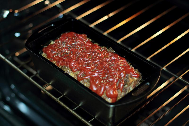 Homemade meatloaf baked in a cast iron loaf pan stock photo