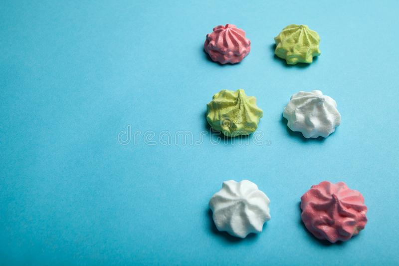 Homemade meringue with love on a blue background, space for text royalty free stock photos
