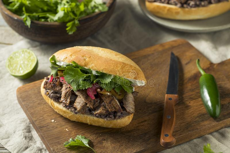 Homemade Mexican Beef Torta Sandwich. With Cilantro and Jalapenos stock photos