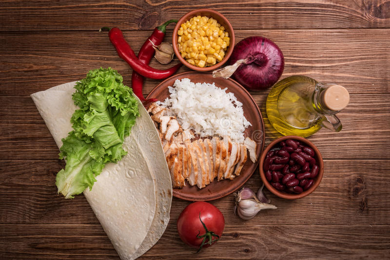 Homemade mexican chicken burrito . stock photos