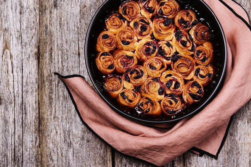Homemade mini cherry rolls in baking form royalty free stock photo