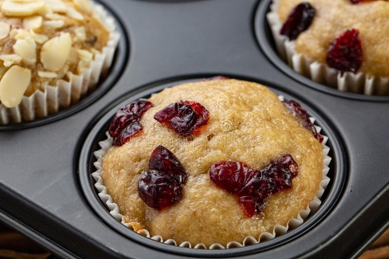 Homemade muffins with cherry in a baking form stock photo