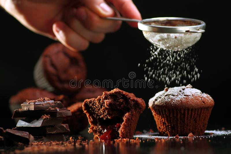 Muffins pouring in powdered sugar stock photo