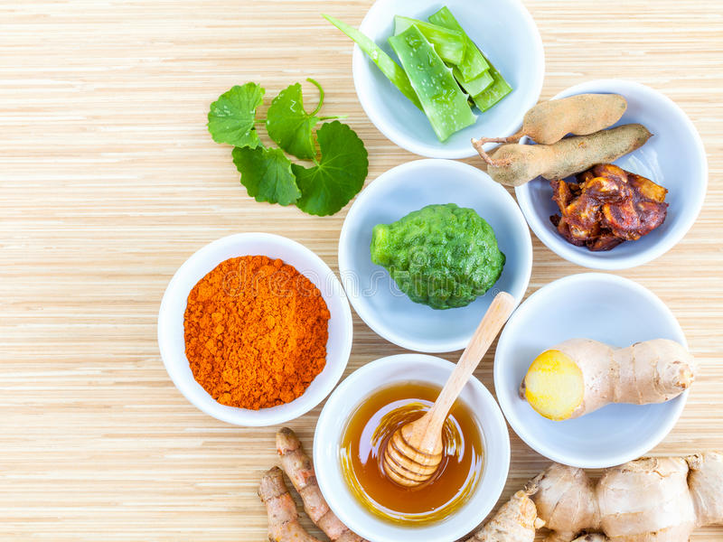 Homemade natural facial toner that for softens. Smoothes,cleanses the skin in bowls with tamarind,honey,turmeric,aloe vera,kaffir lime,Gotu kola and ginger stock photography