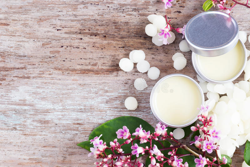 Homemade natural lip balm in tin pots, D.I.Y. projects stock photography