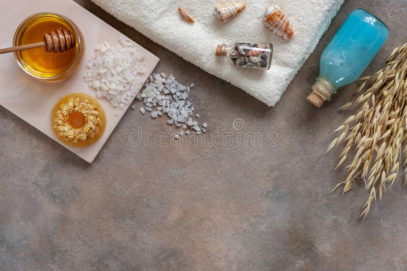 Homemade natural oatmeal soap, fresh honey, sea salt, sea mineral shampoo and towel. Natural skin care. Spa kit for beauty and. Health. Close up, top view royalty free stock images