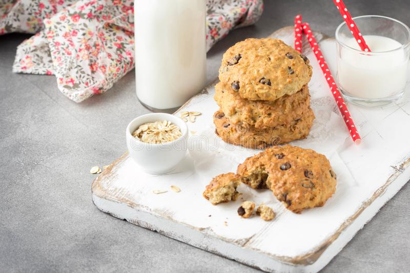 Homemade oatmeal cookies with chocolate and banana, milk in a glass with a tube. Delicious dessert, Breakfast (lunch), healthy royalty free stock image