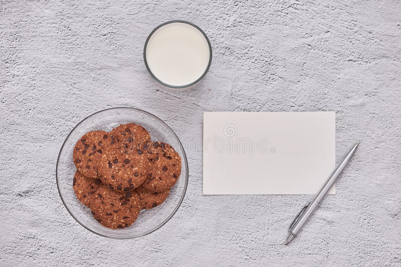 homemade oatmeal cookies with chocolate on an old white background. stock photo