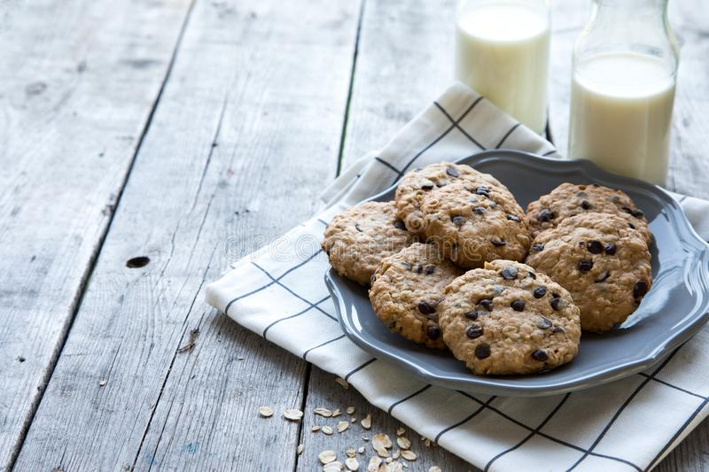 homemade oatmeal cookies with chocolate on an old wooden background stock photos
