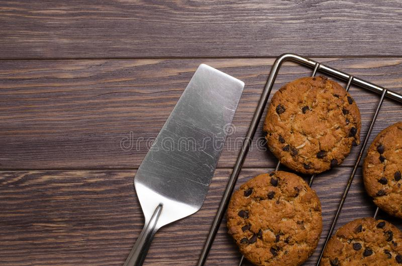 Homemade oatmeal cookies on cooling rack. Wooden background. Fla royalty free stock photography