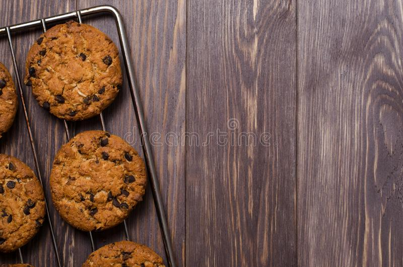Homemade oatmeal cookies on cooling rack. Wooden background. Fla stock images