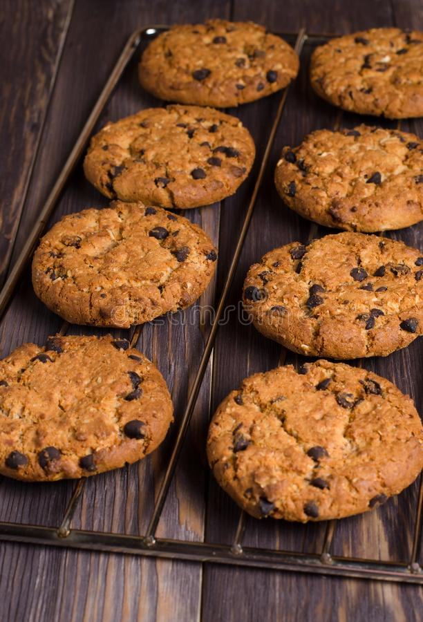 Homemade oatmeal cookies on cooling rack. Wooden background. Sid royalty free stock image