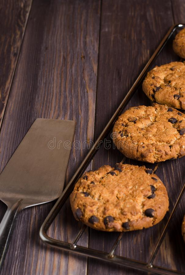 Homemade oatmeal cookies on cooling rack. Wooden background. Sid royalty free stock images
