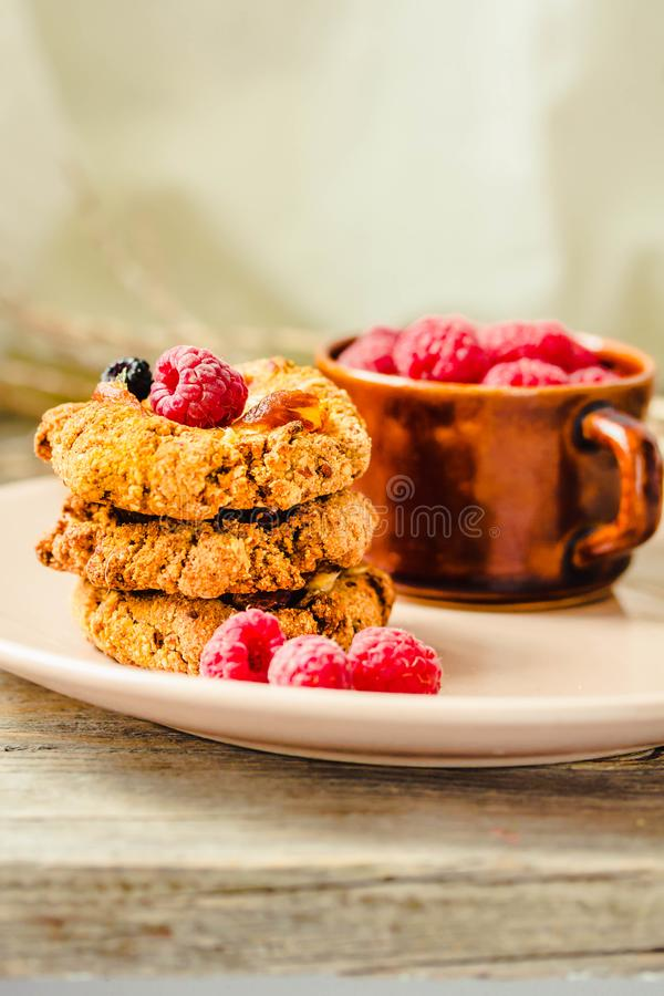 Homemade oatmeal cookies with fresh berry on old wood table background. Healthy Food Snack Concept. Copy space royalty free stock photos
